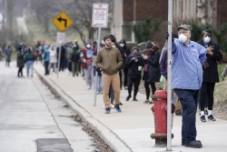 Voters masked against coronavirus line up at Riverside High School for Wisconsin's primary election