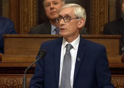 Tony Evers speaking at podium