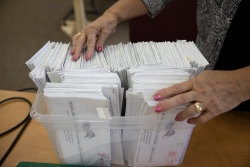 election inspector alphabetizes and organizes absentee ballots