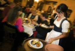 Waitress serving a fish fry to customers at the Bavarian Inn in Glendale