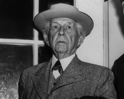 Architect Frank Lloyd Wright at door of the White House