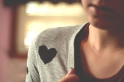 Young person wearing a heart sweater