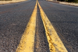 Yellow lines on a highway road