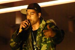 A Black rapper performing