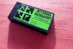 "A box labled ""official geocache"""