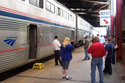 Travelers wait on the platform of the Amtrak station in Milwaukee, Wis.