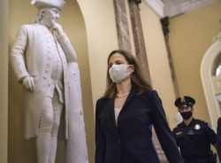 Judge Amy Coney Barrett walks through the U.S. Capitol
