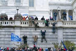 Trump supporters climb the U.S. Capitol