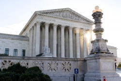 The sun rises over the U.S. Supreme Court building.