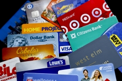 an assortment of credit cards and rewards cards