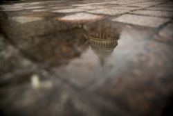 The dome of the U.S. Capitol Building is visible in reflection in Washington,