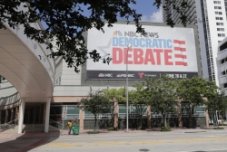 A billboard advertises the Democratic Presidential Debates