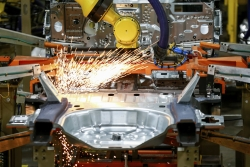 Machines work on Ford vehicle