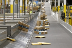 Customer packages on an Amazon conveyor belt