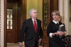 Senate Majority Leader Mitch McConnell, R-Ky., steps out of the chamber during the start of the impeachment trial of President Donald Trump