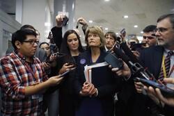 Sen. Lisa Murkowski, R-Alaska, walks with reporters as in the basement of the U.S. Capitol
