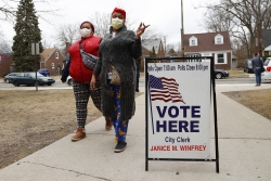Voters arrive at polling place amid COVID-19 outbreak