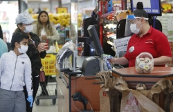 Shoppers buy groceries