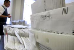 Staffer sorting absentee ballots