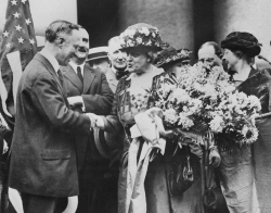 Carrie Chapman Catt is greeted by the former governor of New York