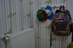 Backpack hanging up in kids room