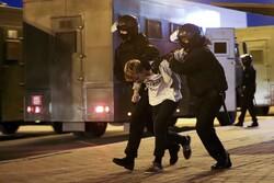 Riot police detain a protester in Minsk, Belarus
