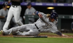 The Brewers' Ben Gamel scores on a double hit