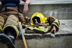 Firefighter sitting next to gear