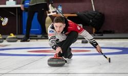 Charlie Thompson of Eau Claire practices curling.