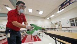 A custodian cleans the cafeteria at a Texas elementary school.