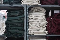 folded clothing on racks