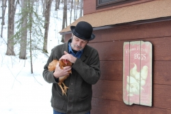 David Tank holding a chicken