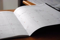 A planner is open to a month view.