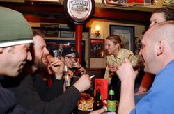 Students enjoy a few beers at a pub.