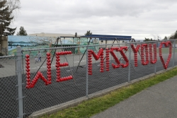 """A sign reads """"We Miss You"""" at Lowell Elementary School in Tacoma, Wash."""