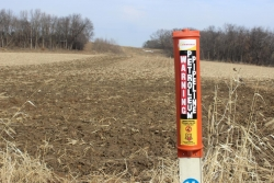 An Enbridgepost marks the Line 61 corridor in a field in Marshall, Wisconsin.