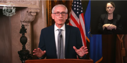 Governor Evers addresses public during video address with an ASL interpreter