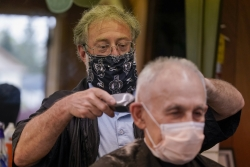 A man gets a haircut in Waukesha, Wis. on May 14, 2020.