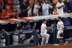 Houston Astros second baseman Jose Altuve is greeted at the dugout manager AJ Hinch.