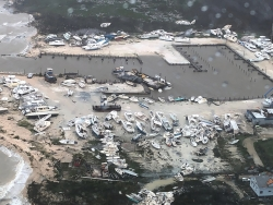 Boats litter the area around a marina in the Bahamas after Hurricane Dorian
