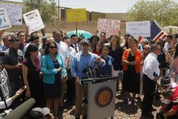 Rep. Joaquin Castro speaks alongside members of the Hispanic Caucus after touring inside of the Border Patrol station in Clint, Texas.
