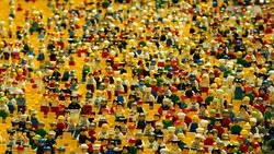 Tons of lego characters standing next to each other to look like a crowd.