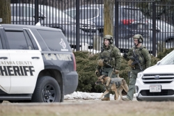 Police work outside the Molson Coors Brewing Co. campus