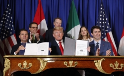 President Donald Trump, Canada's Prime Minister Justin Trudeau, right, and Mexico's President Enrique Pena Neto