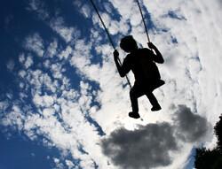 child on swings