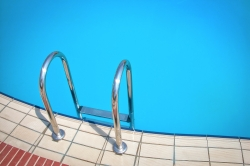 Pool ladder on the side of a pool