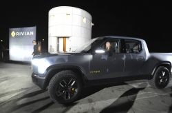 Rivian unveils the first-ever electric adventure vehicle before the LA Auto Show.