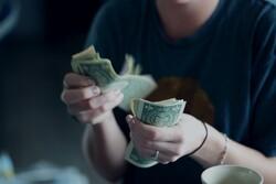 A person counts money