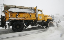 A Milwaukee County plow clears a streetin Wauwatosa