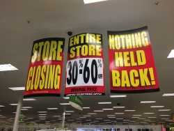 Store closing signs advertise sales